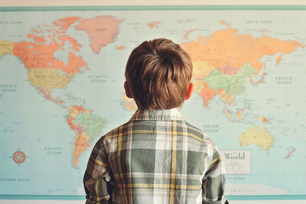 Child looking at a world map